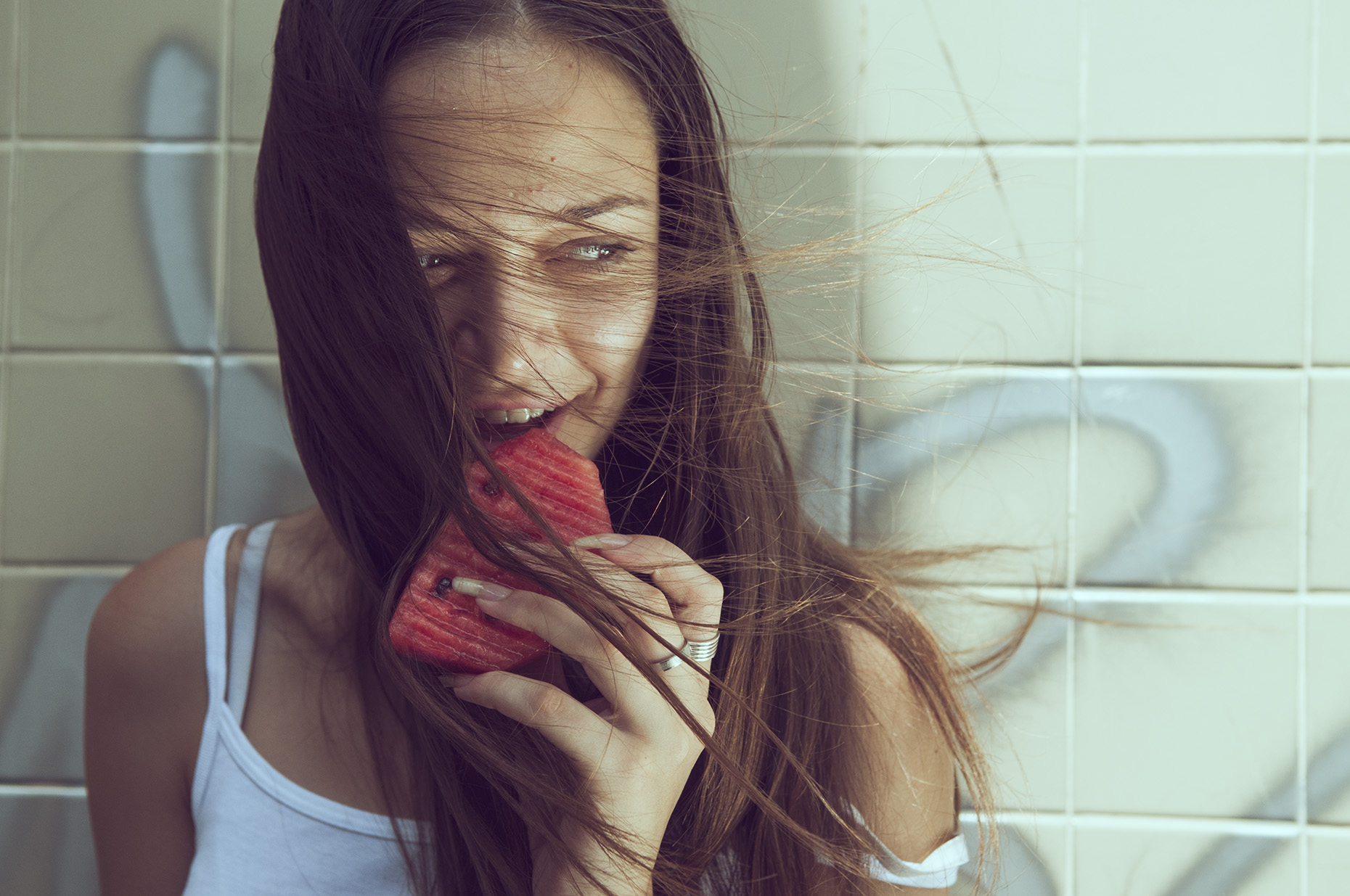 Fashion Photo of a lady eating watermelon