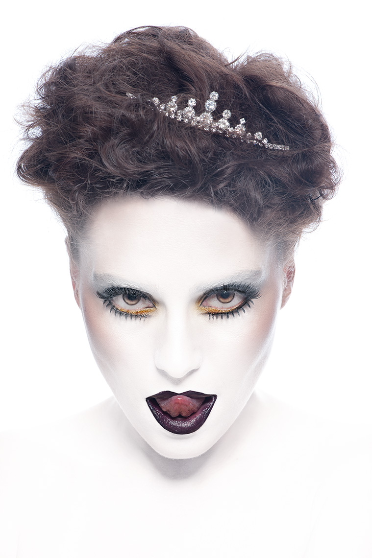 Fashion Photo of a woman with white makeup